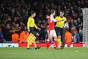 Arsenal defender Shkodran Mustafi (20) talking to the ref during the Champions League round of 16, game 2 match between Arsenal and Bayern Munich at the Emirates Stadium, London, England on 7 March 2017. Photo by Matthew Redman.