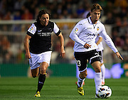 VALENCIA, SPAIN - APRIL 20: (R) Sergio Canales of Valencia CF  is followed by (L) Manuel Iturra of Malaga CF during the Liga BBVA between Valencia CF and Malaga CF at the Mestalla stadium on April 20, 2013 in Valencia, Spain. (Photo by Aitor Alcalde Colomer).