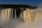 Iguaçù waterfalls, located on the border of the Brazilian state of Paraná and the Argentine province of Misiones, divide the river into the upper and lower Iguazu. View from Argentina's side. The waterfall system consists of 275 falls along 2.7 kilometers of the Iguazu river. The most impressive of all is the Devil's Throat (Garganta del Diablo), a U-shaped cataract of 82-meter-high, 150-meter-wide and 700-meter-long that marks the border between Argentina and Brazil. Two thirds of the falls are within Argentine territory. The first European to find the falls was the Spanish Conquistador Álvar Núñez Cabeza de Vaca (1541), and the falls were rediscovered by Boselli at the end of the nineteenth century. The falls are shared by the Iguazú National Park (Argentina) and Iguaçu National Park (Brazil), designated UNESCO World Heritage Sites in 1984 and 1987, respectively.