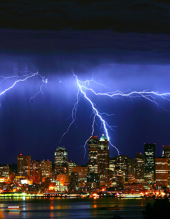 Lightning dances across the Seattle skyline as seen from Admiral Way Viewpoint in West Seattle.