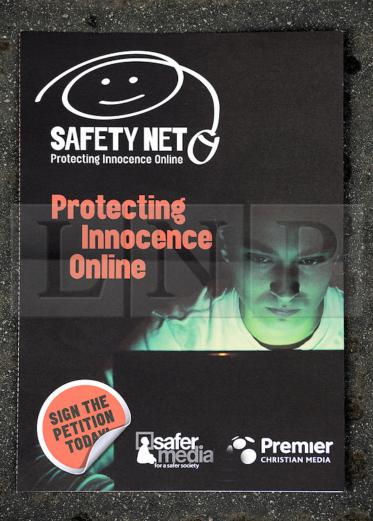 © Licensed to London News Pictures. 06/09/2012. Westminster, UK  A safety net leaflet. A Petition, signed by 110,000 people, calling on the government to make it compulsory for Internet Service Providers to block pornography as a default setting is delivered to Downing Street. More than 140 MPs and peers are among those that have signed the Safetynet campaign.. Photo credit : Stephen Simpson/LNP