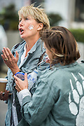 Emma Thompson (here having a paw print painted on her face), and Greenpeace UK Executive Director John Sauven, deliver a celebration speech to crowds outside Shell's offices – in response to yesterday's announcement by , the Anglo-Dutch oil major, Shell that it was pulling out of Arctic oil drilling. After speaking, Emma helped volunteer puppeteers move Aurora the double decker bus sized polar bear from in front of Shell's front door.  The bear has been standing there  for the past month, in protest at Shell's proposed Arctic oil drilling. Now Shell has announced its Arctic exit, the bear will be transported to Paris where the nations of the world will soon gather to negotiate a deal on climate change.