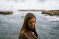 SANTA MARIA DI CASTELLABATE (CASTELLABATE), ITALY - 14 FEBRUARY 2018: Alessia d'Alessandro (28), the Five Stars Movement (M5S, Movimento 5 Stelle) candidate running for the Chamber of Deptuies in the 2018 Italian General Elections, walks around in Santa Maria di Castellabate, where she spent her weekends and summers between the age of 14 and 18, on February 14th 2018.<br /> <br /> Santa Marina di Castellabate is part of the electoral college of Agropoli, in the Campania region (southern Italy) in which Franco Alfieri (Democratic Party, PD, Partito Democratico), politically active for the past 30 years, is running agains the 28-years old Alessia d'Alessandro (Five Stars Movement, M5S, Movimento 5 Stelle).<br /> <br /> The 2018 Italian general election is due to be held on 4 March 2018 after the Italian Parliament was dissolved by President Sergio Mattarella on 28 December 2017.<br /> Voters will elect the 630 members of the Chamber of Deputies and the 315 elective members of the Senate of the Republic for the 18th legislature of the Republic of Italy, since 1948.Santa<br /> <br /> The 2018 Italian general election is due to be held on 4 March 2018 after the Italian Parliament was dissolved by President Sergio Mattarella on 28 December 2017.<br /> Voters will elect the 630 members of the Chamber of Deputies and the 315 elective members of the Senate of the Republic for the 18th legislature of the Republic of Italy, since 1948.