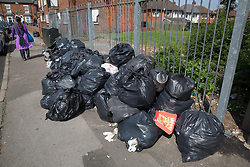 © Licensed to London News Pictures. 25/07/2017. Birmingham, UK. The strike by Birmingham bin men continues as piles of rubbish in certain areas goes uncollected.<br /> Pictured the scene in Tarry Road, Alum Rock.  Photo credit: Dave Warren/LNP