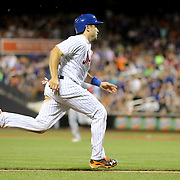 NEW YORK, NEW YORK - July 27: Travis d'Arnaud #18 of the New York Mets runs down the third base line on a pass ball to score a run during the St. Louis Cardinals Vs New York Mets regular season MLB game at Citi Field on July 27, 2016 in New York City. (Photo by Tim Clayton/Corbis via Getty Images)