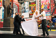 Manhattan, New York, USA: A bride and groom and groomsmen pose for pictures in Times Square, NYC, on Tuesday, January 24, 2012, after City Hall marriage ceremony. Temperatures were unseasonably warm, reaching 52°F / 11°C mid-afternoon.