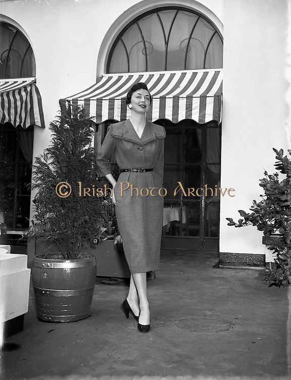 10/05/1955<br /> 05/10/1955<br /> 10 May 1955<br /> N.A.I.D.A. Annual Fashion Parade at the Gresham Hotel, Dublin. Model outside the hotel.