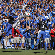 Louisville's wide receiver DeVante Parker grabs a touchdown pass over Kentucky's safety Eric Dixon, left, and defensive back Fred Tiller late in the first half for the game's first touchdown as the University of Kentucky plays the University of Louisville at Commonwealth Stadium in Lexington, Ky. Saturday Sept. 14, 2013. Photo by David Stephenson