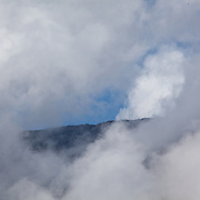 Mountain peaks through a window of clouds, Wayqecha Biological Reserve on the Eastern slopes of the Peruvian Andes. Cloud forest at 2950 meters elevation. The reserve is managed by the Amazon Conservation Association and the Asociación para la Conservación de la Cuenca Amazónica.