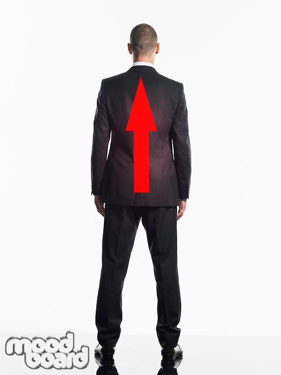 Businessman with Arrow on Back