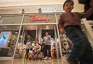 People shop at Disney Store