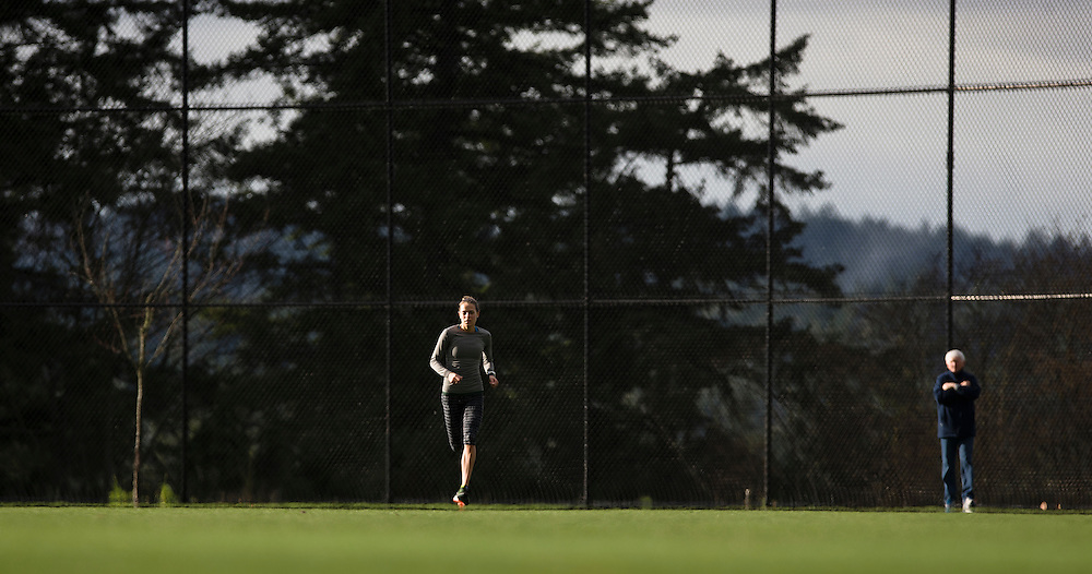 Melissa Bishop runs hill sets under the watchful eye of her personal coach Dennis Fairall at the Pacific Institute for Sport Excellence on December 3rd, 2015 in Victoria, British Columbia Canada.