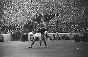 Down back gets tackles by the Kerry forward Kerry attack which went wide during the All Ireland Senior Gaelic Football Final Kerry v Down in Croke Park on the 22nd September 1968. Down 2-12 Kerry 1-13.