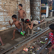 Life in the slums by the  railway tracks in Tejgaon. Homes are build closely to the tracks leading in and out of one of Dhaka's main train stations and life is goes on as in any othr part of Dhaka in spite of the dangerous proximity to the live tracks and trains passing at regular intervals.