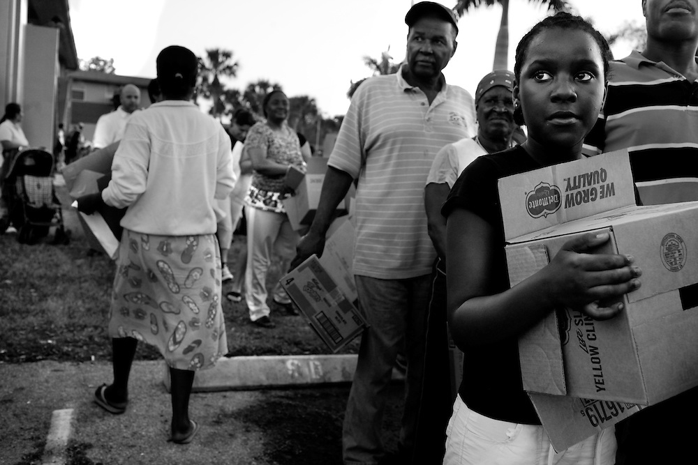Ruth Pierre, 10, right, and others from the Gordon River Apartments, wait in line to receive a box of groceries to from a mobile pantry on Thursday evening. The Coller County Hunger and Homeless Coalition, partnered with Meals of Hope, St. Matthew's House, Collier Harvest, Capital Grille and the Harry Chapin Food Bank offered a hot meal to the Gordon River Park Apartment community and handed out about 50 pounds of groceries to families through a mobile pantry. The organizations are working to offer these free services to different low income communities each week in Collier County. Researchers at the University of Florida were retained by NCEF to update a child well-being study done in 2005 to see where the nonprofit organization has made inroads to improve the health and quality of childrens lives. The 53-page status report on child well-being was completed this past week, just as this years wine festival is set for Jan. 28-30. The reports findings will be studied in detail over the next few months to decide what makes the most sense for future endeavors, especially with multi-year strategic initiatives. For certain, a hunger initiative is on the horizon, according to John Scot Mueller, a trustee and vice chairman of the grant committee. Lexey Swall/Staff  James Klynn has brainstorming session during a Wednesday night get together at his house in Northeast Naples.