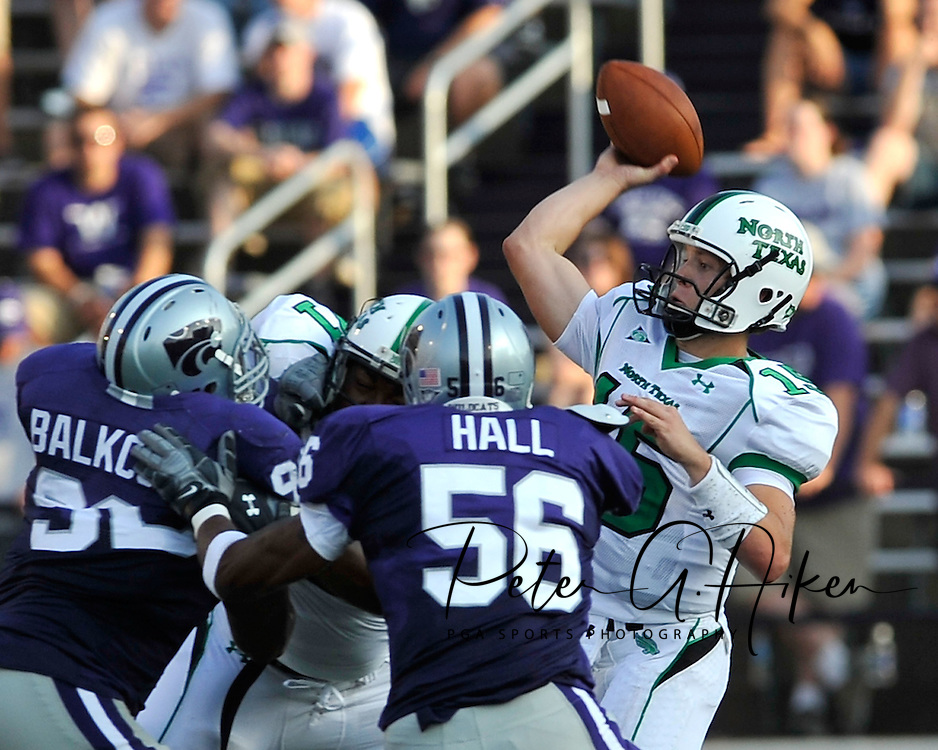 MANHATTAN, KS - AUGUST 30:  MANHATTAN, KS - August 30:  Quarterback Giovanni Vizza #15 of the North Texas Mean Green throws down field in the second quarter against pressure from defenders Olu Hall #56 and Brandon Balkcom #92 of the Kansas State Wildcats on August 30, 2008 at Bill Snyder Family Stadium in Manhattan, Kansas.