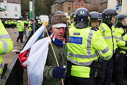 © Licensed to London News Pictures . 30/01/2016 . Dover , UK . Far right protesters at the demonstration . Demonstrations by far-right groups (including The National Front , The North West Infidels and The South East Alliance ) and , opposing them , anti-fascists , close to the port of Dover in Kent . Photo credit : Joel Goodman/LNP