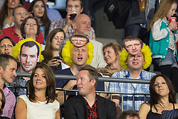 © Licensed to London News Pictures . 03/07/2014 . Leeds , UK . Men in the audience wearing Bradley Wiggins masks and yellow wigs . Tour de France Team Presentation in front of a live audience of 10,000 people at the Leeds Arena and worldwide TV audience in excess of 300 million . Photo credit : Joel Goodman/LNP