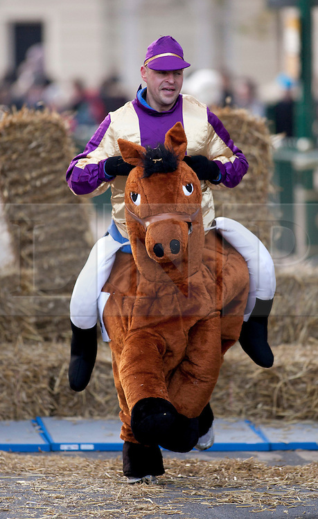 © under licence to London News Pictures 28/11/2010 today picture. Birmingham`s wackiest Christmas event, the annual Pantominme Horse Grand National. The event that sees riders and horses race up and down Broad Street in the City Centre jumping over and even Through straw bales. Pictures shows one of the riders nearing the end of the course..Picture credit: Dave Warren/London News Pictures...