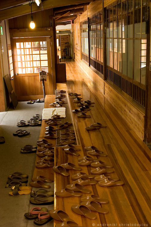 Sleepers to wear indoors and outdoors, near the exit towards the outdoors hot springs, of the 82 years old Ryokan (traditional Japanese hotel) of the Takaragawa onsen (hot spring) in Gunma prefecture north of Tokyo - JAPAN 8 July 2006