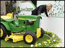 Zara Phillips sits on a John Deere Lawnmower, at the Chelsea Flower Show,to help celebrate 50 years of producing the John Deere lawnmower. Monday, 20th May 2013.Picture by Andrew Parsons / i-Images