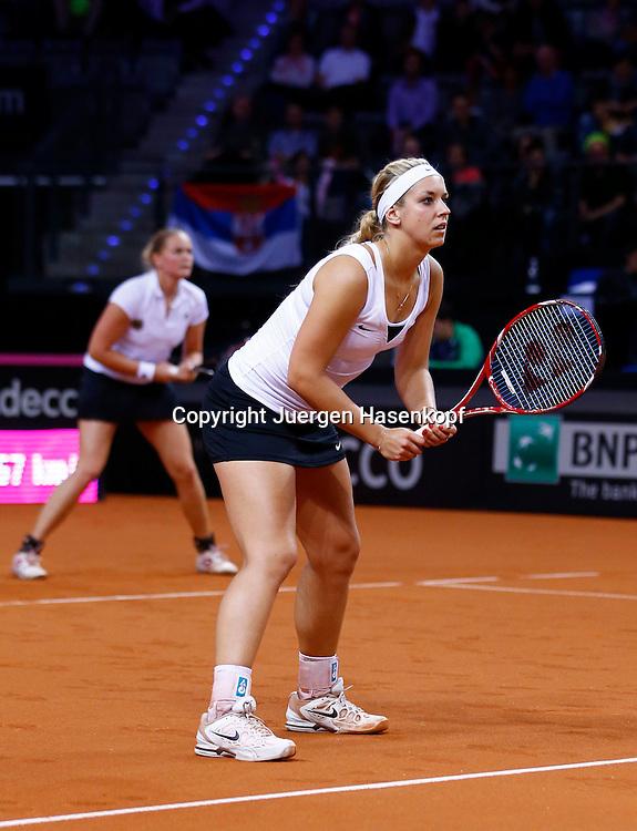 Fed Cup 2013 in Stuttgart, internationales ITF  Damen Tennis Turnier, Mannschafts Wettbewerb, team competition, deutsches Doppel Team, Sabine Lisicki (vorne) und Anna-Lena Groenefeld, Ganzkoerper,.Hochformat,