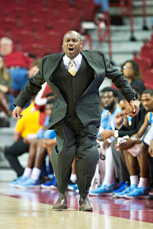 FAYETTEVILLE, AR - NOVEMBER 13:  Head Coach Roman Banks of the Southern University Jaguars jumps in the air during a game against the Arkansas Razorbacks at Bud Walton Arena on November 13, 2015 in Fayetteville, Arkansas.  The Razorbacks defeated the Jaguars 86-68.  (Photo by Wesley Hitt/Getty Images) *** Local Caption *** Roman Banks