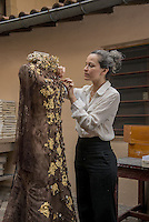 LYON, FRANCE - October 22: For the 20th Salon du Chocolat, Philippe Bernachon asked Florencia Soerensen, a stylist Paraguay, which will create the dress worn by Sophie Thalmann; Florencia had done the dress presented by Marion Bartoli, last year. More than 6kg of chocolate and 250 sheets of gold were necessary for the design of this dress (Photo: Bruno Vigneron)