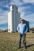Branden Schroeder, co-owner of Schroeder Grain Company, in front of the company elevator in El Reno, Oklahoma.