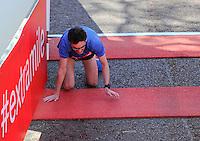 A runner crawls over the finish line<br /> The Virgin Money London Marathon 2014<br /> 13 April 2014<br /> Photo: Javier Garcia/Virgin Money London Marathon<br /> media@london-marathon.co.uk
