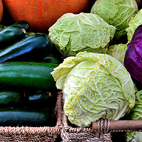 Green, Purple Cabbages and Cucumbers at Farmers Market in Vancouver, Canada