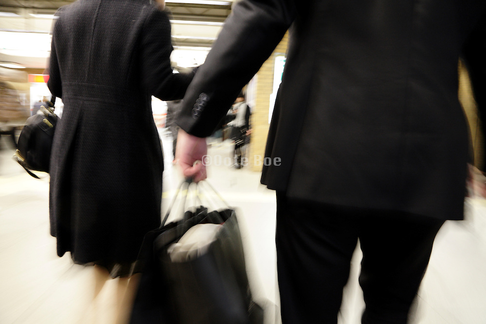 young adult business couple on there way out of a luxury department store in Tokyo