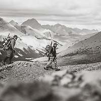 hunters hunting mountains