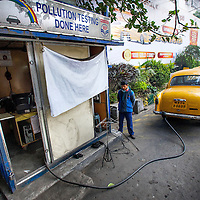 Jan 13, 2013 - A taxi cab driver waits for his car to be smog or pollution test to be completed in Kolkata, India. More than 75% of the vehicles in Kolkata have managed to skip out on the government mandated anti-pollution control testing. The pollution measurements are 20% to 50% higher than safe limits at many parts of the city.<br /> <br /> <br /> Story Summary: It is said that the battle over global warming is to be won or lost in Asia. With growing populations and new economic boom in the global markets across Asia countries like India, Nepal and Cambodia have to grapple with the success and the environmental disaster that comes with ramped up production in unchecked or unregulated industries to compete in todays marketplace. The catastrophic air pollution makes for new problems to be dealt with such as a future health crisis, quality of life issues and the tarnished image of reduced visibility to world heritage sites for tourism.