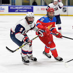 WHITBY, - Dec 17, 2015 -  Game #10 - United States vs. Russia at the 2015 World Junior A Challenge at the Iroquois Park Recreation Complex, ON. Andrew Peeke #9 of Team United States and Nikolay Kovalenko #51 of Team Russia follow the play during the first period.<br /> (Photo: Shawn Muir / OJHL Images)