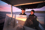 Vermont State Game Wardens Dale Whitlock  and Dana Joyal conduct a dawn patrol on Otter Creek and Lake Champlain in Ferrisburgh, Vermont on the second opening day of duck hunting season.