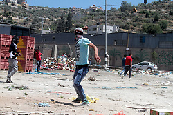 May 26, 2017 - Violent clashes take place between Palestinian demonstrators and the Israeli Security Forces in the West Bank village of Beita, near Nablus. Palestinians were demonstrating in support for Palestinian detainees on hunger strikes in Israeli prisons. Some Palestinians were wounded by tear gas and rubber bullets used by the Israeli Army (Credit Image: © Mohammed Turabi/ImagesLive via ZUMA Wire)