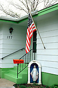 American flag and Virgin Mary in front of house. Brandon Minnesota USA