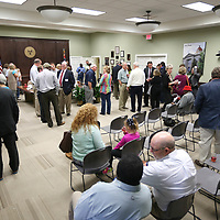 Lauren Wood | Buy at photos.djournal.com<br /> People gather for County Administrator Sean Thompson's retirement reception Monday afternoon at the Lee County Board of Supervisors building.