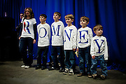 The Fisher family lines up for photos at a campaign rally for GOP presidential candidate Mitt Romney in Elko, Nevada, February 3, 20112.