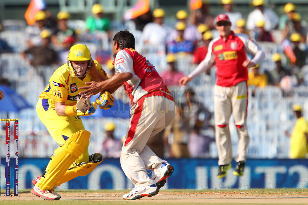 Praveen Kumar clashes with Michael Hussey during match 45 of the Pepsi Indian Premier League between The Chennai Superkings and the Kings XI Punjab held at the MA Chidambaram Stadium in Chennai on the 2nd May 2013..Photo by Ron Gaunt-IPL-SPORTZPICS   .. .Use of this image is subject to the terms and conditions as outlined by the BCCI. These terms can be found by following this link:..http://www.sportzpics.co.za/image/I0000SoRagM2cIEc