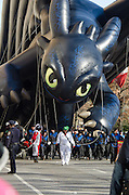 "NEW YORK, NY, USA, Nov. 28, 2013. A balloon depicting ""Toothless,"" a character in the animated movie ""How to Train Your Dragon"" moves down Central Park West during the 87th Annual Macy's Thanksgiving Day Parade. The Toothless balloon is new to the parade this year."