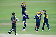 Liam Dawson, Brad Wheal & Will Smith of Hampshire celebrate the wicket of Jim Alllenby during the Royal London One Day Cup match between Hampshire County Cricket Club and Somerset County Cricket Club at the Ageas Bowl, Southampton, United Kingdom on 2 August 2016. Photo by David Vokes.