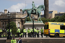 © Licensed to London News Pictures . 03/06/2017 . Liverpool , UK . Hundreds of police manage the two protests. Far-right street protest movement , the English Defence League ( EDL ) , hold a demonstration in Liverpool , opposed by anti-fascists , including Unite Against Fascism ( UAF ) . Photo credit: Joel Goodman/LNP