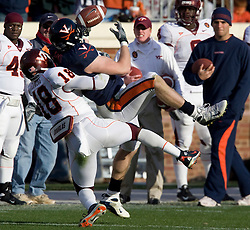 Virginia tight end Tom Santi (86) makes a pass reception while being tackled by Virginia Tech cornerback Brandon Flowers (18).  The #8 ranked Virginia Tech Hokies defeated the #16 ranked Virginia Cavaliers 33-21 at Scott Stadium in Charlottesville, VA on November 24, 2007.