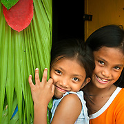 LUCBAN (Philippines). 2009. Childs at the door of her house at the Pahiyas Festival in Lucban.