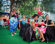 """At the annual Classic Women's Tea Party friends and fellow Ms. District of Columbia's current and past gather to celebrate their community and the creativity of host Elvera Patrick (not pictured) at her Congress Heights, DC 19th century farmhouse, known as """"The Pink Palace."""" (photo by Susana Raab/Institute)"""