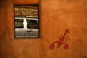 Image of a wall detail with car passing by in downtown Santa Fe, New Mexico, American Southwest