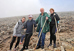 Despite the cancellation notices many pilgrims braved the conditions to climb Croagh Patrick amoung them Toni, Mary, Frank and Bridget Rooney from Ballindine.<br /> Pic Conor McKeown