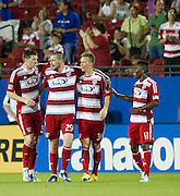 FRISCO, TX - JUNE 12:  Kenny Cooper #33 of FC Dallas celebrates his second goal of the game against the Houston Dynamo with teammates Eric Hassli #29, Michel #31 and Fabian Castillo #11 on June 12, 2013 at FC Dallas Stadium in Frisco, Texas.  (Photo by Cooper Neill/Getty Images) *** Local Caption *** Kenny Cooper; Eric Hassli; Michel; Fabian Castillo
